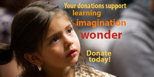 "Small girl with message: ""Your donations support learning, imagination, wonder. Donate today!"""