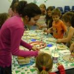 Teen volunteer doing a craft with children