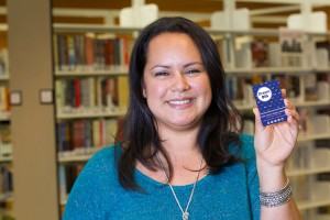 Elizabeth holds her Dream Big library card