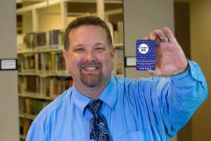 Ken holds his Dream Big library card