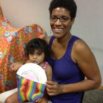 photo of woman and child with craft at rainbow storytime